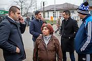 Local inhabitants meeting in front of the polling station in Marginenii de Jos. Left non Roma mayor Manole Aurelian, in the back Roma activist Marius Tudor, Dumitru Nica Florin ( local Roma councilor) and Moraru Nicolae (non Roma councilor).