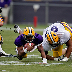 18 April 2009: LSU quarterback Russell Shepard (10) dives forward for extra yardage during the 2009 LSU spring football game at Tiger Stadium in Baton Rouge, LA.