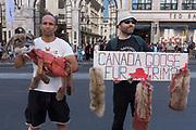 Animal rights activists stage a demo outside Canada Goose store on Regents Street on 30th June 2018 in central London in the United Kingdom. Canada Goose has faced global criticism for the use of fur-trimmed hoods, hats, down-filled jackets and parkas. Demonstrations have been held outside the retail brands flagship shop on Regent Street since opening in 2017. PeTA, People of the Ethical Treatment of Animals are running campaigns to stop Canada Goose selling real fur on all products.