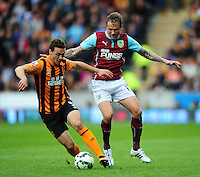 Hull City's James Chester shields the ball from Burnley's Matthew Taylor<br /> <br /> Photographer: Chris Vaughan/CameraSport<br /> <br /> Football - Barclays Premiership - Hull City v Burnley - Saturday 9th May 2015 - Kingston Communications Stadium - Hull<br /> <br /> © CameraSport - 43 Linden Ave. Countesthorpe. Leicester. England. LE8 5PG - Tel: +44 (0) 116 277 4147 - admin@camerasport.com - www.camerasport.com
