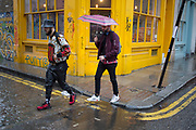 Some pretty hectic fashion on a wet day on Brick Lane in the East End of London, UK.