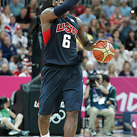 04 August 2012: LeBron James sets a play as he brings the ball upcourt during 99-94 Team USA victory over Team Lithuania, during the men's basketball preliminary, at the Basketball Arena, in London, Great Britain.