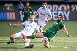 November 4, 2018 - Portland, OR, U.S. - PORTLAND, OR - NOVEMBER 04: Seattle Sounders defender Chad Marshall (14) anticipates Portland Timbers midfielder Diego Valeri (8) during the Portland Timbers first leg of the MLS Western Conference Semifinals against the Seattle Sounders on November 04, 2018, at Providence Park in Portland, OR. (Photo by Diego Diaz/Icon Sportswire) (Credit Image: © Diego Diaz/Icon SMI via ZUMA Press)