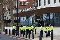 Scotland Yard, London, March 23rd 2017. Police march past Scotland Yard towards the scene of the ongoing investigation in the aftermath of Tuesday's terrorist attack on Westminster Bridge and in the grounds of Parliament, in which four people and their attacker were killed with over 40 injured.