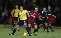 Photo: Alan Crowhurst.<br />Watford v Brighton & Hove Albion. Coca Cola Championship. 03/12/2005. <br />Watford's Gavin Mahon (L) challenges for the ball with Dean Hammond.