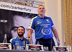 WBO world heavyweight title challenger Hughie Fury (left) and trainer Peter Fury who reacts to an react to an interruption by boxing promoter David Higgins during a pre-fight press conference at the Landmark Hotel, London.