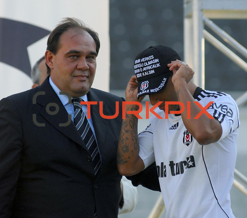 Besiktas Istanbul's new Portuguese soccer player Ricardo Quaresma (R) and Besiktas president Yildirim Demiroren (L) poses for the media after signing a contract with Turkish soccer club Besiktas at Inonu stadium in Istanbul June 19, 2010.Photo by TURKPIX