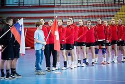 Players of Switzerland listening to the national anthem during handball game between Women National Teams of Slovenia and Switzerland in 2014 Women's European Championship Qualification, on March 30, 2014 in Arena Kodeljevo, Ljubljana, Slovenia. Photo by Vid Ponikvar / Sportida