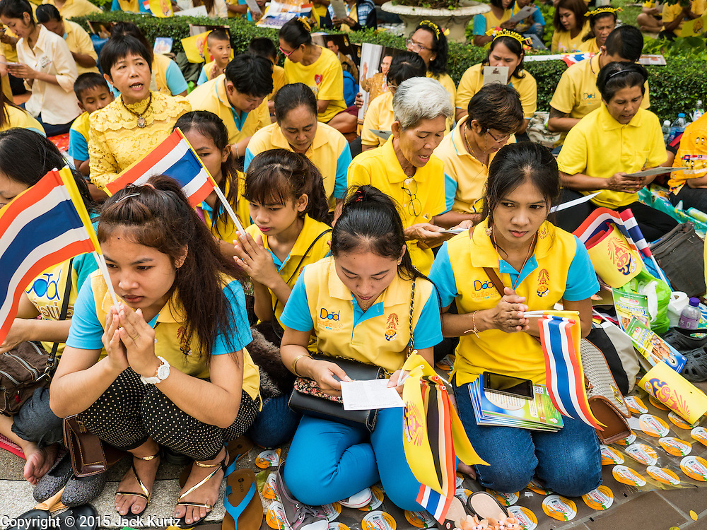 05 DECEMBER 2015 - BANGKOK, THAILAND: People pray for the King in the plaza at Siriraj Hospital on the 88th birthday of Bhumibol Adulyadej, the King of Thailand. Hundreds of people crowded into the plaza hoping to catch a glimpse of the revered Monarch. The King has lived at Siriraj Hospital off and on for more than four years.     PHOTO BY JACK KURTZ