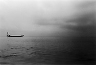 A lonely fishing boat floats quietly off Koh Tonsay (Rabbit Island), Cambodia, Southeast Asia