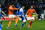 Josh Ginnelly (14) of Bristol Rovers battles for possession during the EFL Sky Bet League 1 match between Bristol Rovers and Blackpool at the Memorial Stadium, Bristol, England on 15 February 2020.