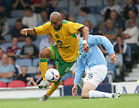 leon mckenzie on attack after beating andy edwards.-FRIENDLY SOUTHEND V NORWICH-23 JULY 2005-PIC BY KIERAN GALVIN / COLORSPORT