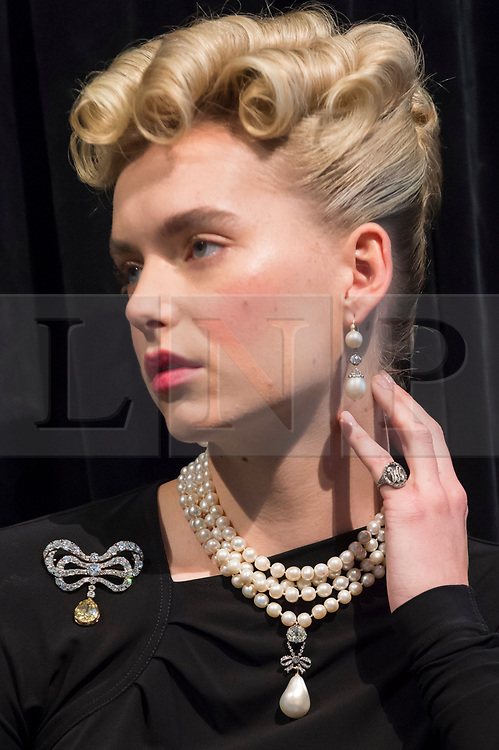 """© Licensed to London News Pictures. 19/10/2018. LONDON, UK. A model wears Marie Antoinette's jewels comprising (L to R) a diamond brooch, second half of the 18th century (Est. USD 50k-80k), a natural pearl and diamond necklace comprising three rows of 116 graduated pearls (Est USD200k-300k), a natural pearl and diamond necklace (Est USD40k-70k), """"Queen Marie Antoinette's Pearl"""", a natural pearl and diamond pendant 18th century set (Est USD1m-2m), a pair of natural and pearl diamond pendant earrings, late 18th century (Est USD200k-300k) and a monogrammed ring containing a lock of the queen's hair (Est. USD8k-10k).  Preview of Sotheby's """"Royal Jewels from the Bourbon-Parma Family"""", a family descended from Louis XIV of France, the Holy Roman Emperors and from Pope Paul III, with links to the most important ruling families of Europe. Led by a breath-taking group of jewels which once belonged to Marie Antoinette, queen of France, the collection of jewels will be offered for sale at Sotheby's in Geneva on 14 November 2018.  Photo credit: Stephen Chung/LNP"""