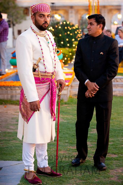 Lakshaya Raj, son and heir of 76th Maharana of Mewar, Shriji Arvind Singh Mewar of Udaipur, at Holi Festival at the City Palace, Rajasthan, India.