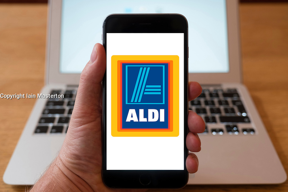 Using iPhone smartphone to display logo of Aldi budget discount supermarket chain