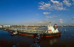 Aerial view of a tanker being moved by tugboats in the Port of Houston