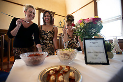 Tammy Hulme, from left, Gina Renfroe and Deanna Lambka, all of Lodi, Calif., pose with their gourmet Spam chips and dip at the 22nd annual Spam Festival, Sunday, Feb. 16, 2019, in Isleton, Calif. Spam lovers competed for prizes by presenting their favorite Spam-infused foods, or entering the Spam-eating and Spam-toss contests. (Photo by D. Ross Cameron)