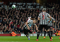 Football - 2018 / 2019 Premier League - Arsenal vs. Newcastle United<br /> <br /> Matt Ritchie (Newcastle United) heads clear in front of Alexandre Lacazette (Arsenal FC) at The Emirates.<br /> <br /> COLORSPORT/DANIEL BEARHAM
