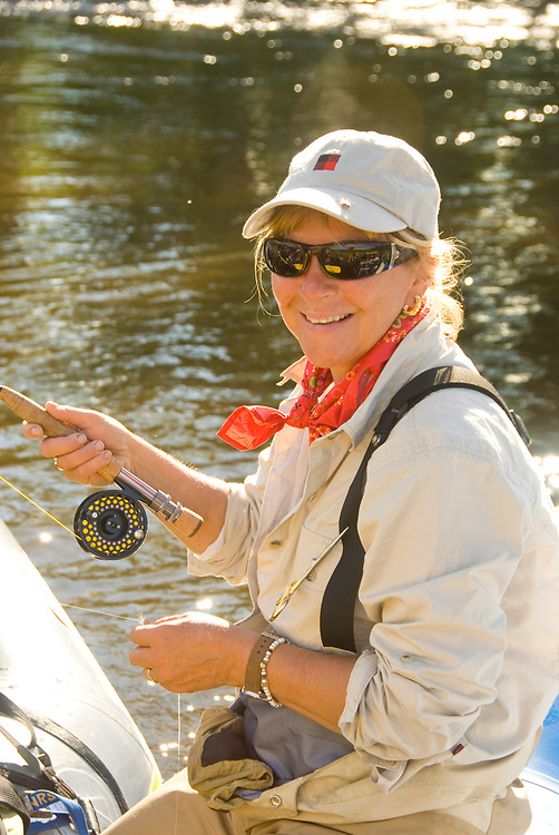 Alaska Southwest, Female fly fishing guide prepares for a day of fishing the King Salmon River.  MR