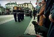 Francois Mitterrand Funeral in his home town of Jarnac in the Charente in south western France 11 January 1996<br />The former Presidents black Labrador Baltique looks on as his former masters coffin