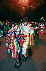 12 Feb 2015. New Orleans, Louisiana.<br /> Mardi Gras. Members of the Krewe of Rolling Elvi make their way along Magazine Street  with the The Krewe of Muses. <br /> Photo; Charlie Varley/varleypix.com