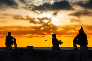 People watching sunset at the sea in Essaouira, Morocco.