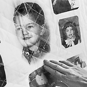 Blayne Kinart's brother Harold touches a boyhood photo of Blayne on a quilt made of photos from Blayne's life.  58-year-old Blayne Kinart a former chemical worker who died from Mesothelioma, a cancer associated with asbestos exposure in Sarnia, Ontario. Residents of the area have nicknamed Sarnia ?Chemical Valley?, due to the large number of chemical plants operating in the area. Blayne passed away on July 6, 2004.