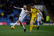 Marcus Maddison of Peterborough United is tackled by Rob Dickie of Oxford United during the EFL Sky Bet League 1 match between Oxford United and Peterborough United at the Kassam Stadium, Oxford, England on 16 February 2019.