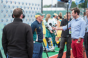 Australian coach Adam Commens does a post match interview after their game against the USA during the Investec Hockey World League Semi Final 2013, Quintin Hogg Memorial Sports Ground, University of Westminster, London, UK on 27 June 2013. Photo: Simon Parker