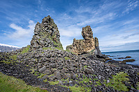 The Londrangar stacks, perched on the western tip of the Snæfellsnes peninsula, were first scaled in the 18th century by a young fisherman.