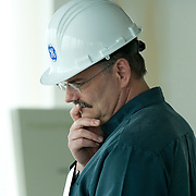 Man at a General Electric construction site.<br /> Agency: Edelman<br /> Photography: Brett Gilmour