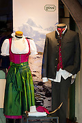 Traditional Tyrolean suit and dirndl dress in shop window in Herzog Friedrich Strasse in Innsbruck in the Tyrol, Austria