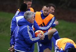 © Licensed to London News Pictures. 22/12/2015. London, UK. Chelsea football club interim manager Guus Hiddink carries a ball in sight of team captain John Terry during a training session at the club's Cobham ground. Photo credit: Peter Macdiarmid/LNP