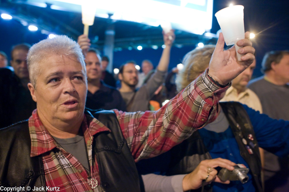 November 10, 2008 -- PHOENIX, AZ: Gay rights supporters hold up candles during a vigil for gay rights in Phoenix Monday. About 250 people attended a candle light vigil in support of gay rights and gay marriage in Phoenix, AZ, Monday night. The rally, like similar ones in Los Angeles and Salt Lake City, were in response to anti-gay marriage and anti-gay rights initiatives that were passed by the voters in Arizona, California and Florida. The anti-gay initiatives in Arizona and California were funded by conservative churches, including the Church of Latter Day Saints (Mormons). Photo by Jack Kurtz / ZUMA Press