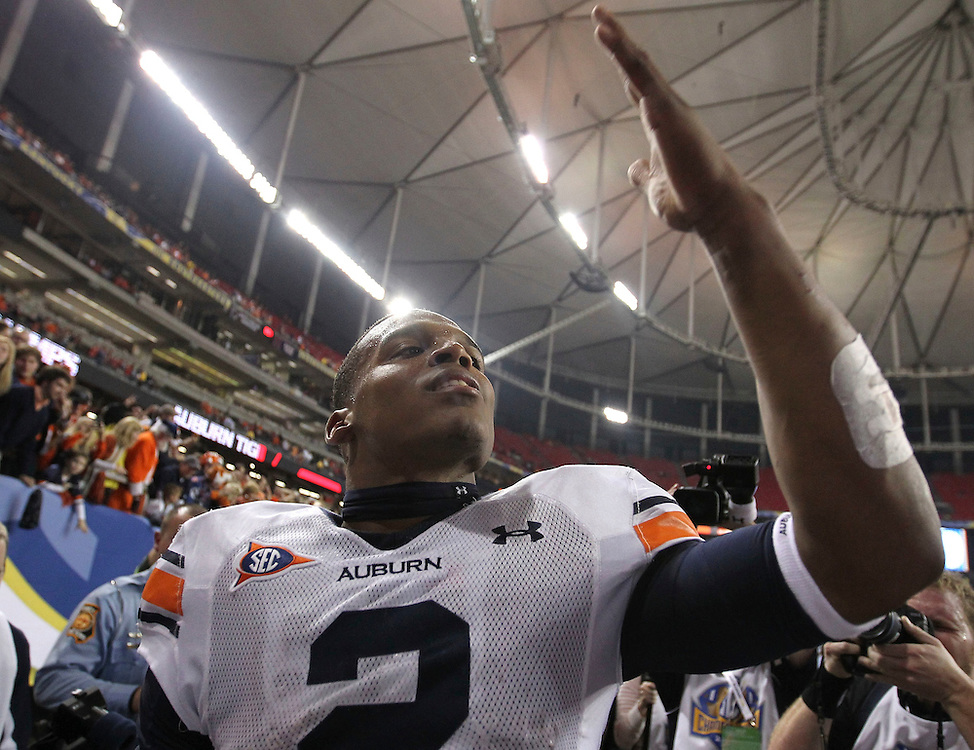 ATLANTA - DECEMBER 4:  Quarterback Cam Newton #2 of the Auburn Tigers blows a kiss to the crowd after the 2010 SEC Championship against the South Carolina Gamecocks at Georgia Dome on December 4, 2010 in Atlanta, Georgia.  The Tigers beat the Gamecocks 56-17.   (Photo by Mike Zarrilli/Getty Images)