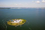 Nederland, Noord-Holland, Pampus, 14-07-2008; Forteiland Pampus, Rijksmonument, onderdeel van de Stelling van Amsterdam, wereld erfgoed onderdeel van de Werelderfgoedlijst van Unesco; het fort is gerenoveerd, voorzien van een nieuw dak en koepels; in de achtergrond Amsterdam-IJburg, in het IJmeer (Buiten-IJ); artillerie, geschut, Eerste Wereldoorlog, mobilisatie; .Island Fort, was built at the end of the 19th century as part of the Stelling van Amsterdam, a ring of 42 defensive works around the capital.. .luchtfoto (toeslag); aerial photo (additional fee required); .foto Siebe Swart / photo Siebe Swart