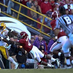 November 6, 2010; Baton Rouge, LA, USA;  LSU Tigers running back Stevan Ridley (34) breaks the tackle by Alabama Crimson Tide cornerback Mark Barron (4) during the second half at Tiger Stadium. LSU defeated Alabama 24-21.  Mandatory Credit: Derick E. Hingle