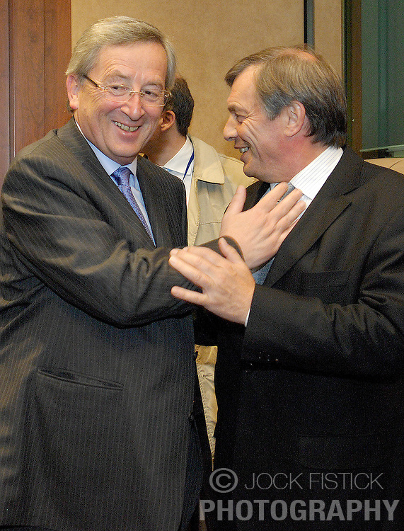 Jean-Claude Juncker, Luxembourg's prime minister, and president of Eurogroup, greets Jeannot Krecke, Luxembourg's minister of economy and foreign trade, as they arrive for the monthly Eurogroup meeting at the EU council headquarters in Brussels, Belgium, Monday, May, 4, 2009. (Photo © Jock Fistick)