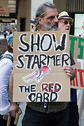 A man holds a sign critical of Labour Party leader Sir Keir Starmer at a protest lobby outside the partys headquarters by supporters of left-wing groups on 20th July 2021 in London, United Kingdom. The lobby was organised to coincide with a Labour Party National Executive Committee meeting during which it was asked to proscribe four organisations, Resist, Labour Against the Witchhunt, Labour In Exile and Socialist Appeal, members of which could then be automatically expelled from the Labour Party.