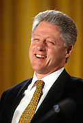 US President Bill Clinton laughs during a White House event April 2, 1997 in Washington, DC.