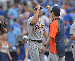 Sep 20, 2014; Kansas City, MO, USA; Detroit Tigers relief pitcher Joe Nathan (36) is congratulated by manager Brad Ausmus (7) after the game against the Kansas City Royals at Kauffman Stadium. Detroit won 3-2. Mandatory Credit: Denny Medley-USA TODAY Sports