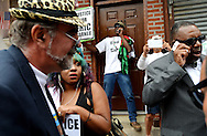 People gather near a memorial for Eric Garner, who was killed by a New York City police officer, at the start of the 'We Will Not Go Back' march against police brutality in Staten Island, New York, USA, 23 August 2014.