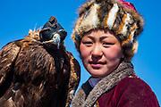 Portrait of young Kazakh eagle huntress, Altai Mountains, Bayan Ulgii, Mongolia