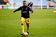 Wimbledon defender Tennai Watson (2), on loan from Reading, warming up  during the EFL Sky Bet League 1 match between Coventry City and AFC Wimbledon at the Ricoh Arena, Coventry, England on 12 January 2019.