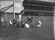 Group of players tackle for the ball during the All Ireland Senior Gaelic Football Final Down v. Offaly in Croke Park on the 24th September 1961.Down 3-6 Offaly 2-8.