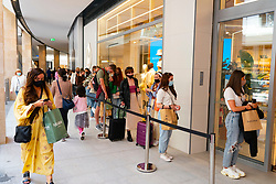 Edinburgh, Scotland, UK. 24 June 2021. First images of the new St James Quarter which opened this morning in Edinburgh. The large retail and residential complex replaced the St James Centre which occupied the site for many years. Pic; Long queue of shoppers outside Stradivarius shop. Iain Masterton/Alamy Live News