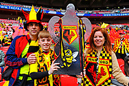 A family of Watford fans with an FA Cup cut out before the The FA Cup Final match between Manchester City and Watford at Wembley Stadium, London, England on 18 May 2019.