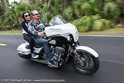 Brian Klock of Klock Werks in Mitchell, SD with Vanessa Nay ride in Tamoka State Park on their 2017 Jack Daniels Indian Chieftain limited edition that Brian designed for Indian during Daytona Beach Bike Week. FL. USA. Monday March 13, 2017. Photography ©2017 Michael Lichter.