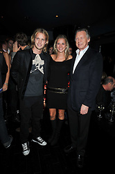Left to right, SAM BRANSON, HOLLY BRANSON and JOHN STEPHEN at the launch of the new Chinawhite at 4 Winsley Street, London on 21st October 2009.