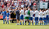 Photo: Daniel Hambury.<br />Gillingham v West Ham United. Pre Season Friendly. 29/07/2006.<br />Gillingham's former player Andy Hessenthaler (far left) is clapped onto the pitch by both sets of players for his testimonial.